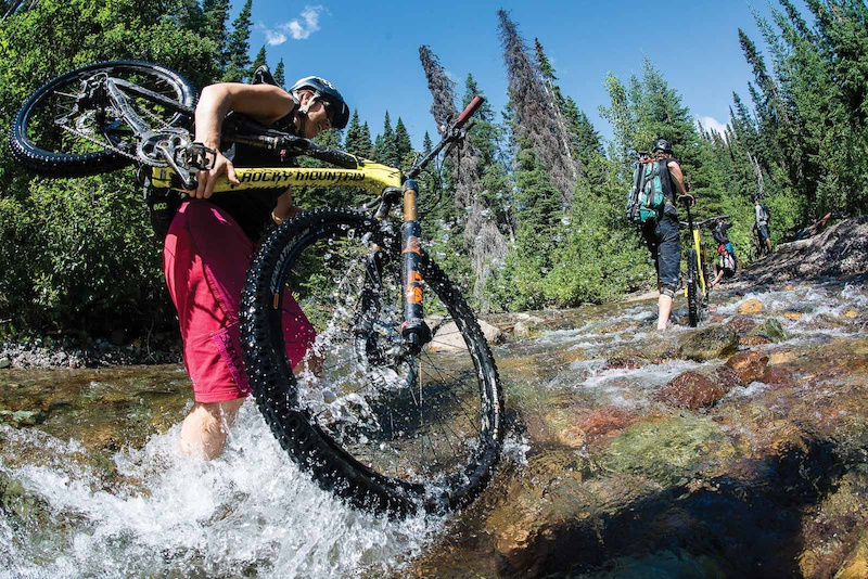 Kelli Sherbinin of Endless Biking crosses a creek on the way to Cronin Pass outside of Smithers BC. Photo John Wellburn