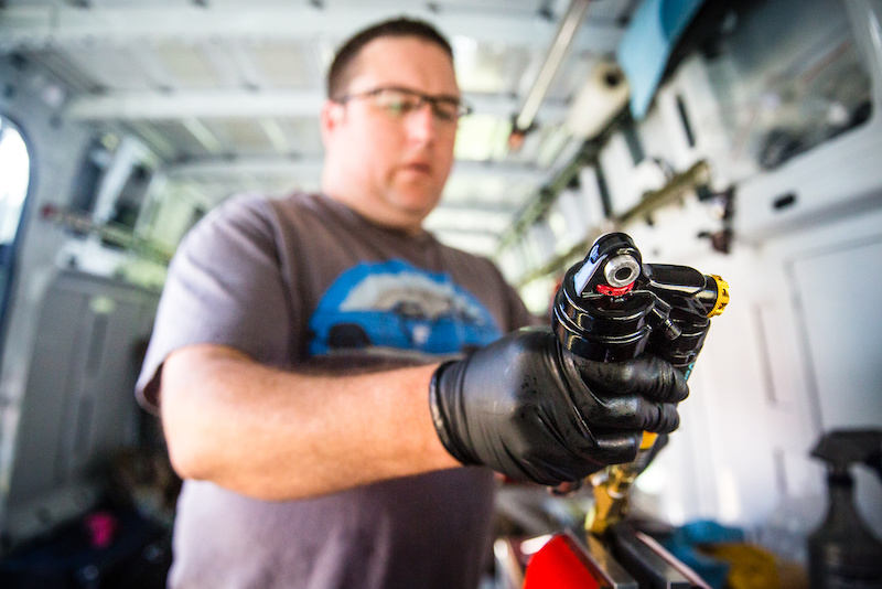 Mike D. from X-Fusion was hands on all weekend first rebuilding and servicing the athletes suspensions then tuning them for the fast course of this round.