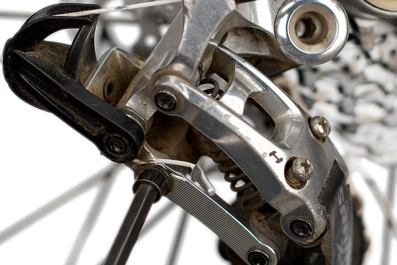 Re clamp the shift cable with the chain on the smallest cog