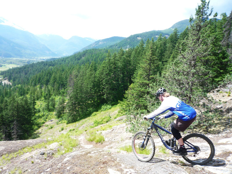 Ever ridden Grumpy Grouse in Pemberton? If you aren't going to ride this section you better hope that you have some sticky soled shoes to walk down it! Sharon about to roll over the knuckle and into the silliness - Hell ya!