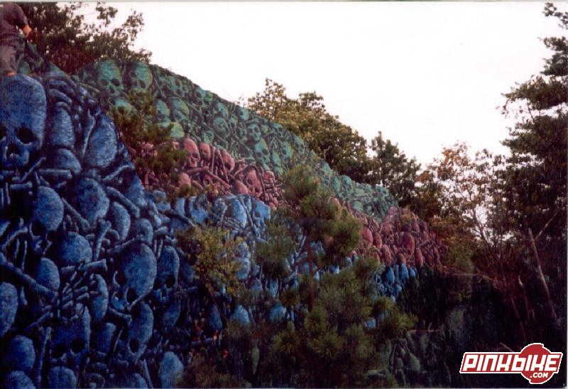 This is one crazy graffety job. This cliff is called Skull Rock. It is about 30 to 40 feet tall and it is just about the coolest thing I have ever seen. Each skull is painted right down to the last detail. You should go see it for your self.