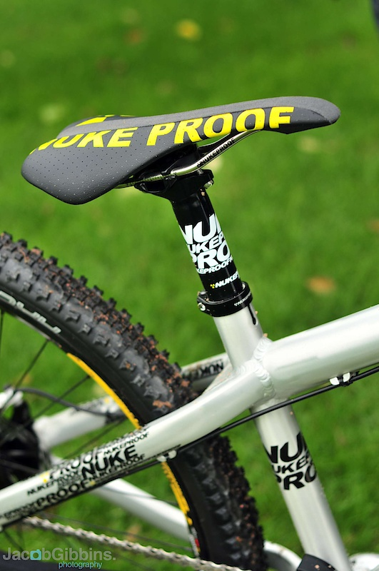 It's a subtle change and one which is perhaps not picked up on by many, but the name in previous years has been 'Nuke Proof', but revised graphics bring about a consolidation to 'Nukeproof'.  Moving from utilitarian graphics, these look much slicker and bring with them an increased number of finishing options: Lacquered raw, Yellow & Black.  The raw shown here is very brushed, the final is likely to be more along the lines of the pedals seen below which feature a more tarnished effect.