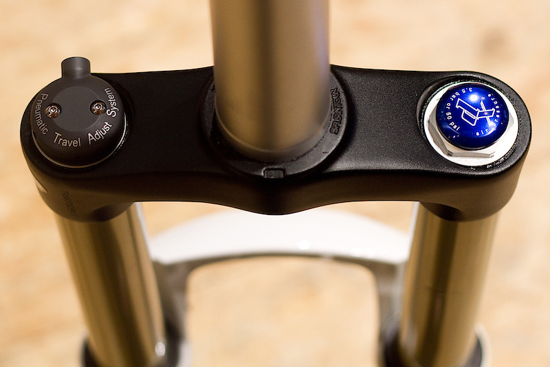 Rider's view of the remote travel adjust Durolux TAD fork that allows for either 120-160 mm or 140-180 mm of range via a sealed air cartridge and bar mounted remote. While there are other long travel adjustable length forks out there, not many of them use a remote to get the job done, this may appeal to some riders. Depending on what features you are looking for, the Durolux line is available in 140, 160, and 180 mm travel options if you are looking for a fork with a set amount of travel. Adjustable travel can be found on the TAD models and goes from 120-160 mm or 140-180 mm.