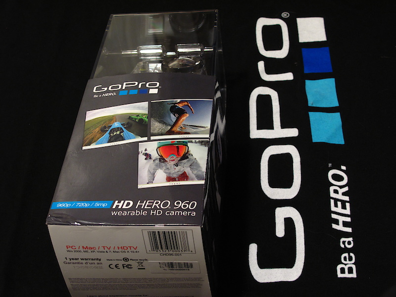 The big news at GoPro this year was the introduction of a second HD model that has been added to help bring the same near-bombproof HD video to the masses at a very attractive pricepoint. Here's a run-through of the goods. The new camera, the HD Hero 960 is designed to be price conscious with simplicity in mind. GoPro has cut out a few options (1080p, 60fps recording and the Hero Bus expansion port) to bring it in at an even lower price. It keeps its 720p and 960p at 30 fps, and also retains its 5 megapixel photo function. The cutback in features on the 960 equates to a rather large cut in price. The HD Helmet Hero released last year retails for $299.99USD while the new 960 starts shipping to retail stores this week for just $179.99USD.