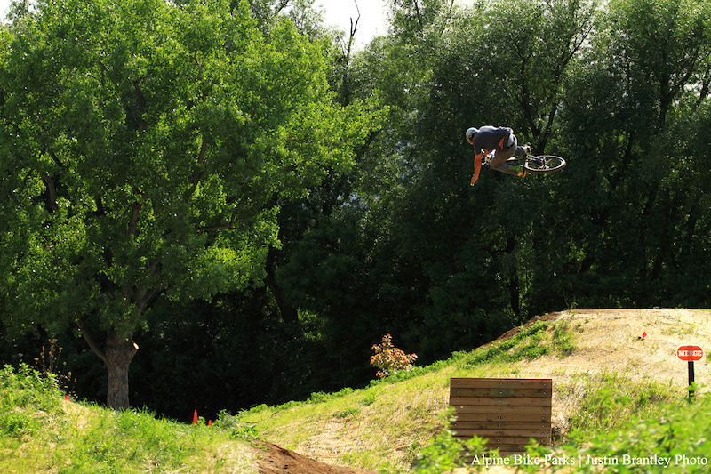 Opening day at Valmont Bike Park Here Cob aws the crowd with a nicely boosted table