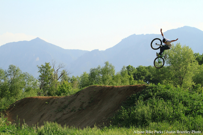 Opening Day at Valmont Bike Park. R-Dogg was throwing down on every run on the new dirt jumps at the end of the day Here he does a nicely extended tuck no hander