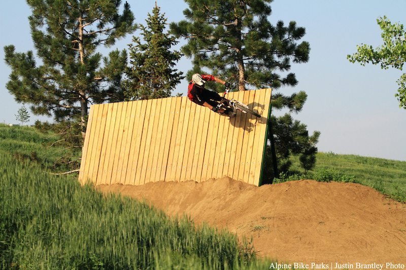 Riding the wallride at the end of the dirt jump line