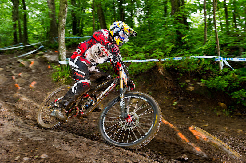 Aaron Gwin putting the new Carbon Trek Session to work during a rainy practice day at Mt St Anne. No specs on the bike. Likely about 35 lbs with that ti spring and other light weight tricks that Monkey has been known to pull keep weight down. Now gossip amongst yourselves with speculation...