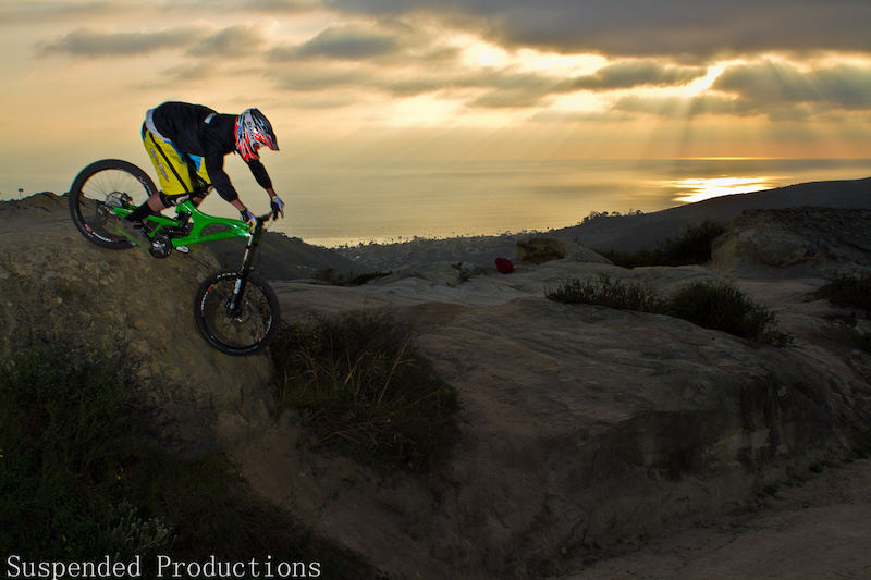 Yes that is Dan Danyul The Photographer and yes he is riding a Downhill bike
