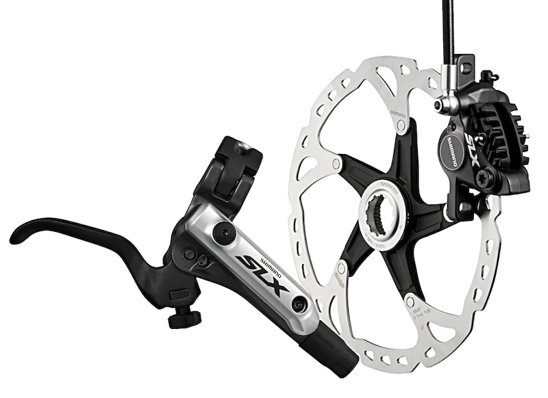 SLX brakes are big news. Ice Tech XTR and XT has gained traction among the best rider in the sport as the best of the best. SLX shares the ceramic pistons finned pads and aluminum-sandwich rotors below and the crisp-feeling Servo Wave action shorty brake lever design above.