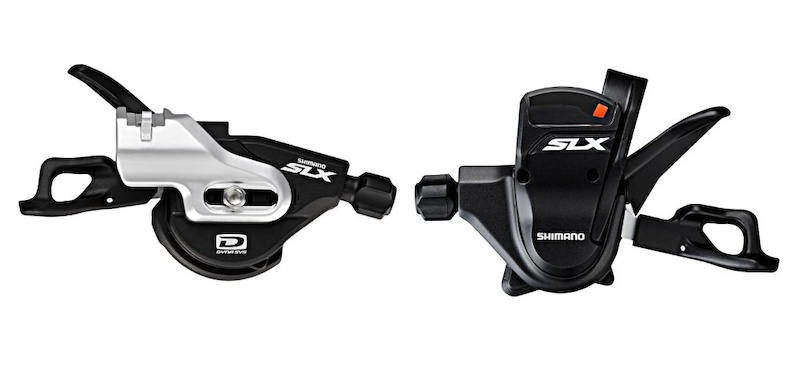 SLX shift levers have been reprofiled and the mech upgraded with the two-by three-by mode-change switch that was once exclusive to XTR and XT. The left shifter is the ISPEC integrated clamp design while the right features the optional indicator and standard handlebar clamp mount.