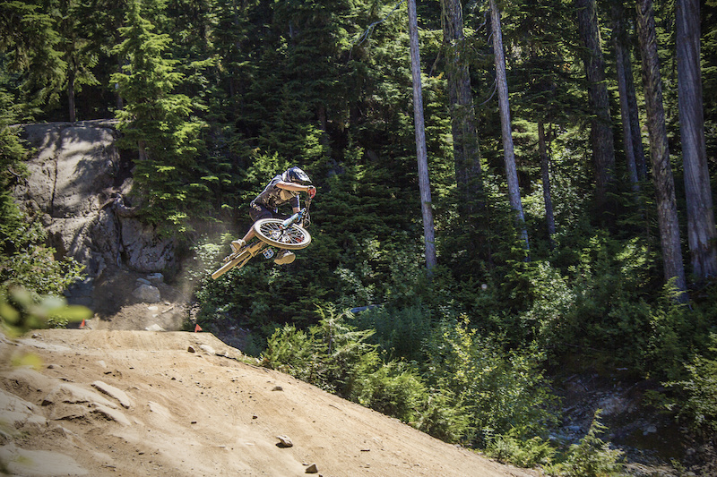getting stylish on drop in clinic in whistler bike park.