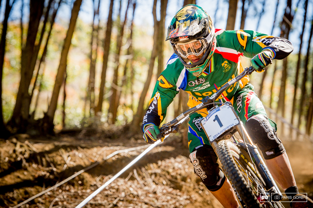Greg Minnaar fully focused while Nelson Mandela watches over him today.