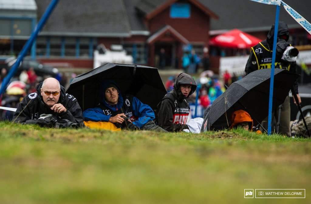 Nearly the whole of the World Cup photo core stayed huddled up to keep hypothermia at bay in the driving wind and rain.
