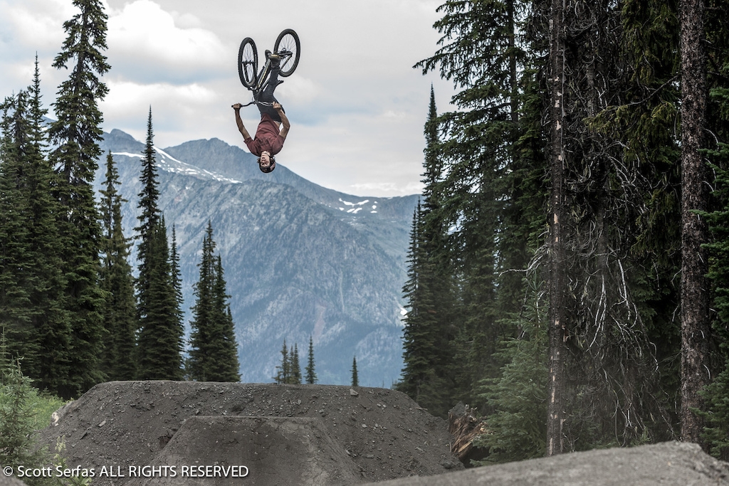 Brandon Semenuk performs on his mountain bike at Retallack Lodge near Nelson BC Canada on August 1st 2013.