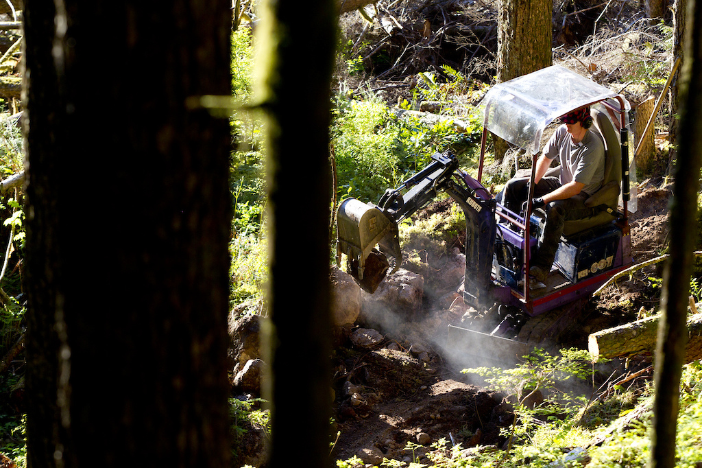 Ted Tempany building another trail in Squamish with the Mini Excavator. Photographer John Gibson