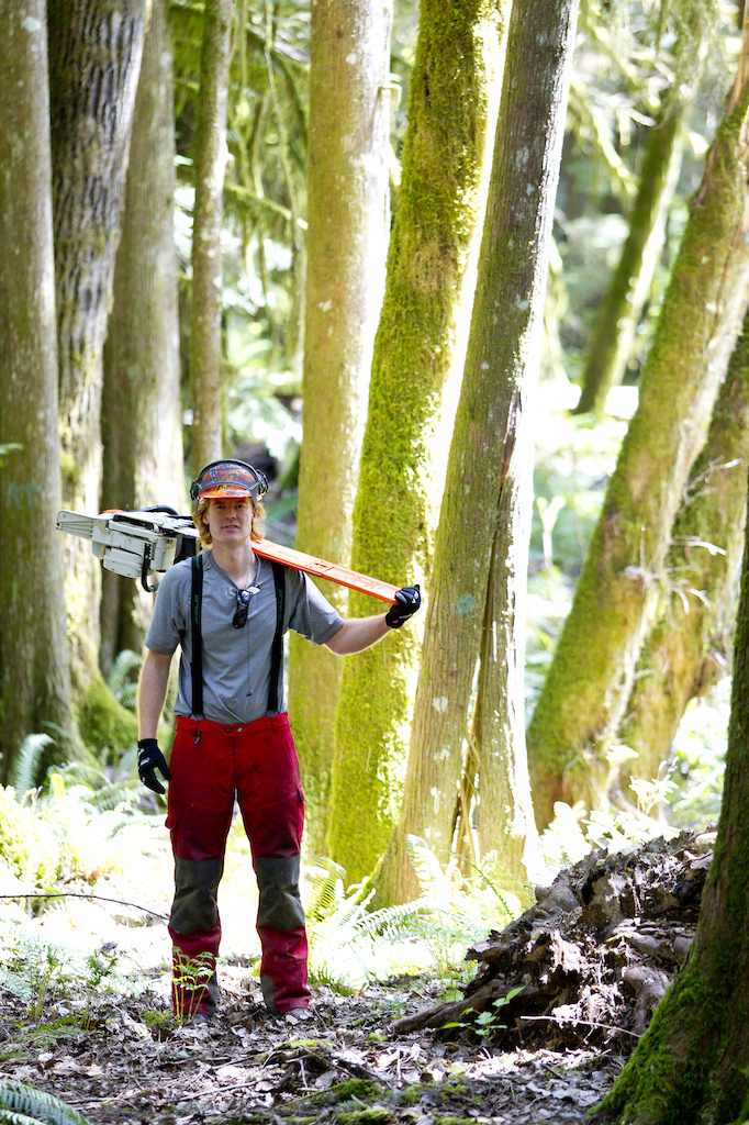 Ted Tempany cuts down dead trees that have fallen over an existing mountain bike trail in Squamish. Photographer John Gibson