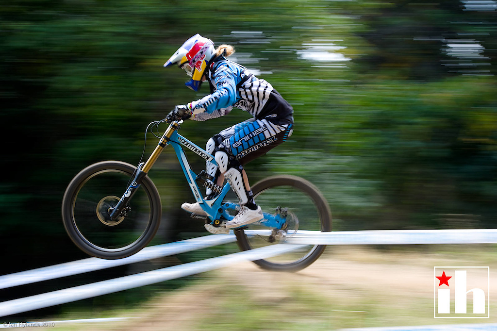 Rachel Atherton, in this 1/50th pan blur Rachel and most of her bike is fairly solid, background blurred. It looks fast.