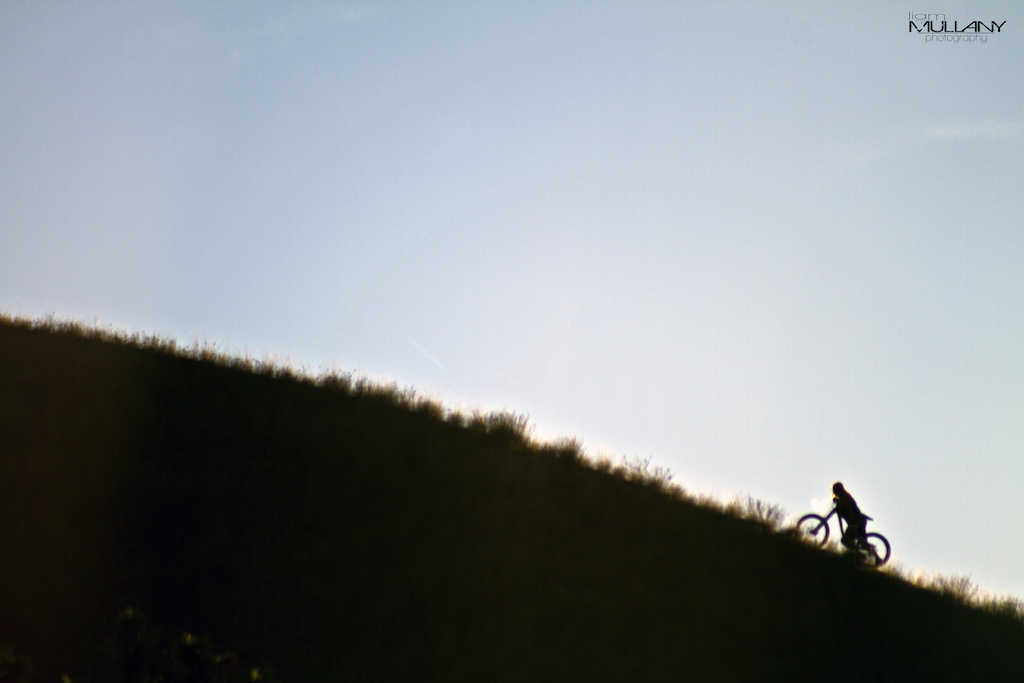 Evan hiking the ridge in the early sun for an upcoming edit
