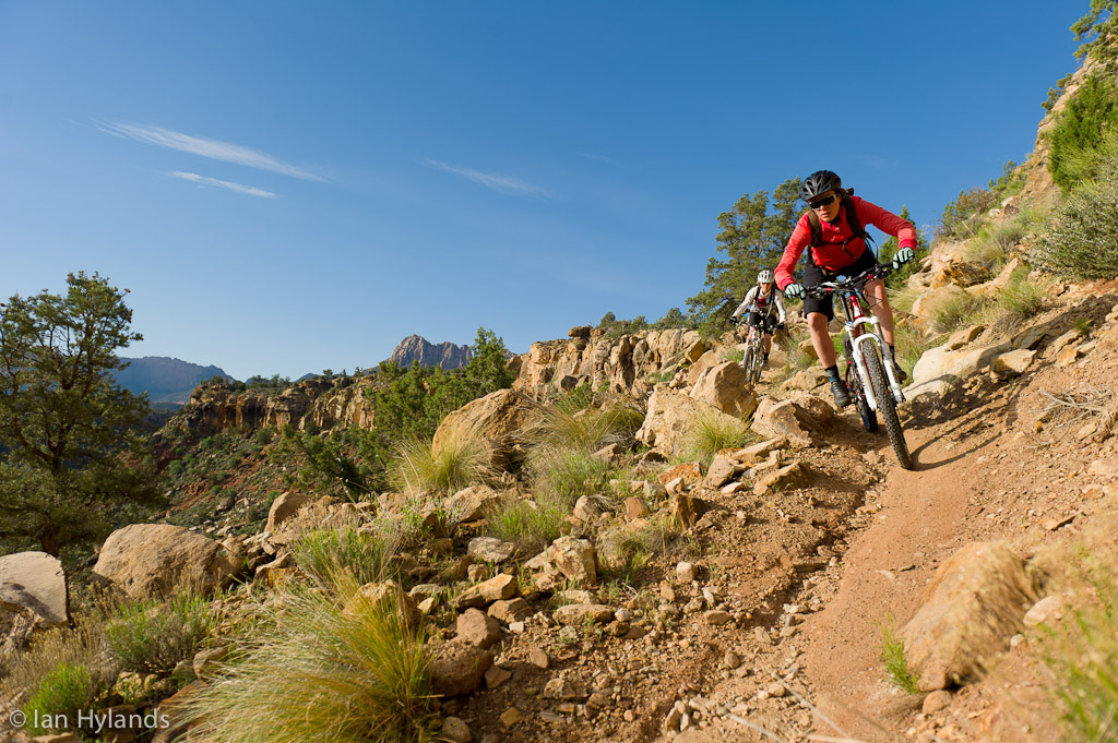 Brook Baker and Katrina Strand riding the Grafton Mesa Trail near Rockville in Utah.
