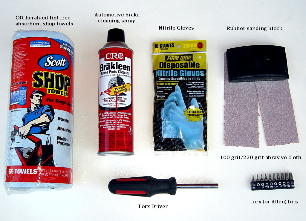 What you need: dedicated shop towels are a good idea because aerosol brake cleaner will eat additives and plastics in cloth or parer-type napkins and could cause more trouble. Eye protection is a good idea too when using chemicals. We show you the tools necessary to remove Magura brake pads. You'll need a slightly different kit to remove other types of pads. Finally. we used 100-grit abrasive because it gets the job done quickly. If your rotors use a spider, then make a sanding block from a paint stirring stick or similar, or carefully work the rotor with the edge of the rubber block.
