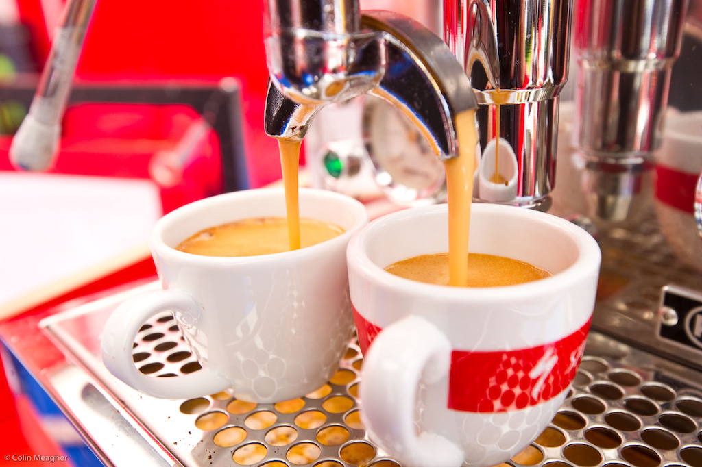 The competition in the pits for the best cup of coffee won t be heating up until Val di Sole. My call is that the espresso pulled off of the new Specialized Factory Racing rig will take the win. But SRAM is rumored to be throwing down on a burr grinder and a new Italian machine.