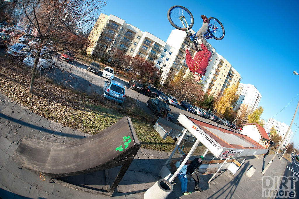 Piotrek Krajewski backflip at the bus stop with his Quinnie. Photo by Jan Kili ski. Ride Your Way 2 Bling.