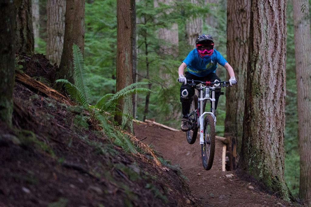 Holly Feniak rides her bicycle on the sunshine coast of BC