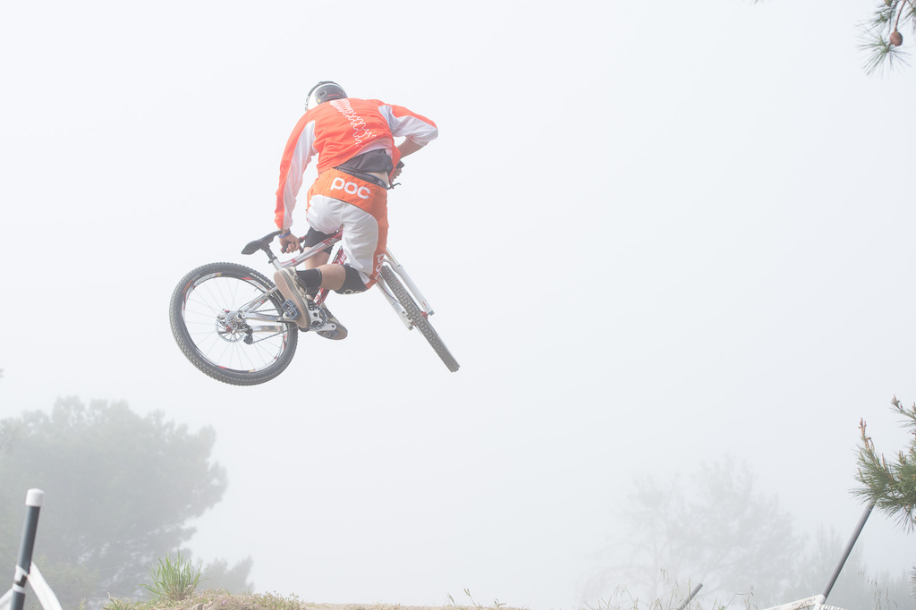 Lear Miller getting whipped in the fog. Race day practice for the DH.
