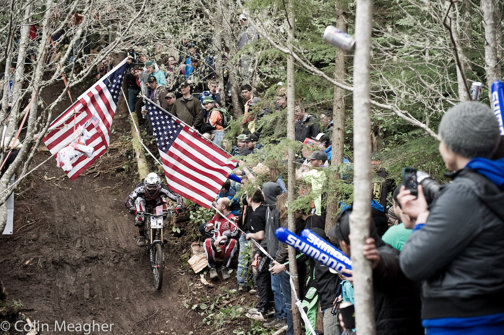 Title Sponsor Diamondback s Kyle Thomas parting the red white and blue curtains in the waterfall line.