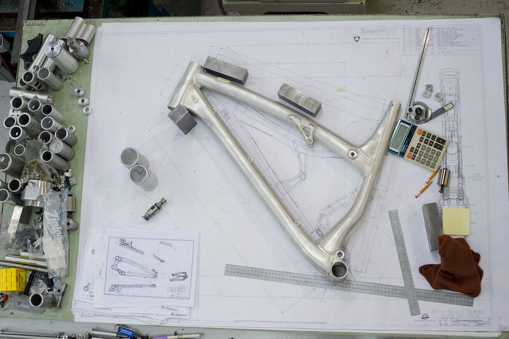 A new frame sits on the table atop plans for a new custom Flatline being built up for Thomas Vanderham