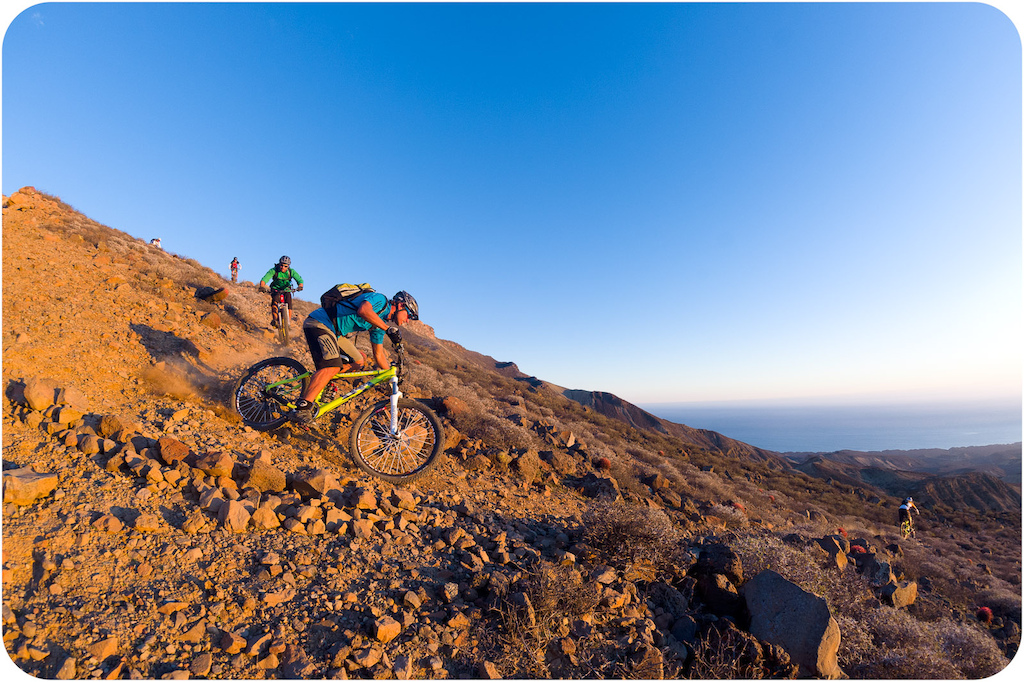 Richie Schley Joey Sanchez and Leigh Donovan ride down the mesa trail at Punta San Carlos.