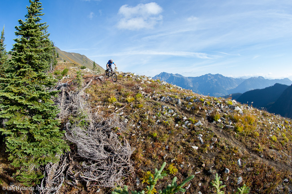 Lindsey Voreis rides her bike in the Alpine above Retallack Lodge near Kaslo BC