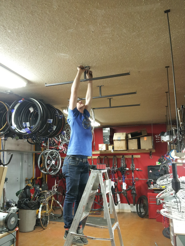 Never enough storage  Zach installing some more custom tire and wheel ceiling racks