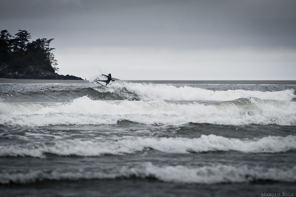 I wish I could post a photo of one of the Rocky crew slashing waves but unfortunately they didn t look as good as this un-named local. Cox Bay Tofino BC.