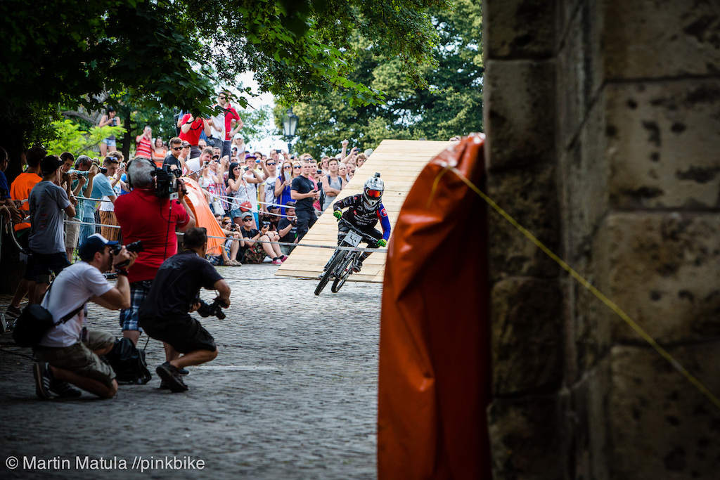 The turn for the wallride after the master drop called for strong brakes and good flat cornering skills. Local rider Lukas Ucen rails the beaten cobblestones hard.