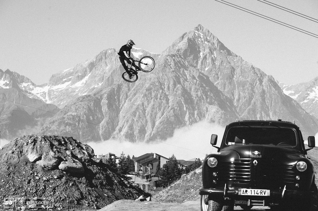 Brett Rheeder jumps the lower road gap and into the final jump. Mountains giving a not too terrible backdrop in Les 2 Alps.