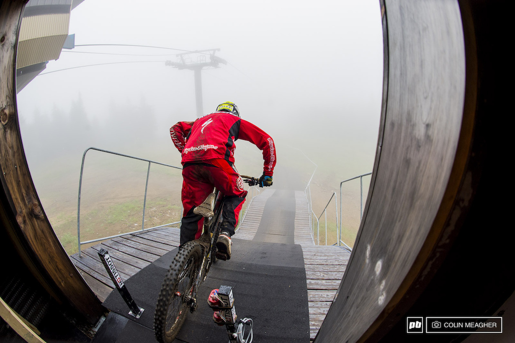 Into the void... Mitch Ropelato dropping in. Condtions were literally thick as pea soup on the top section of track. The motorway was riding by braille. It wasn t until riders got into the woods that they could actually see what they were hitting.