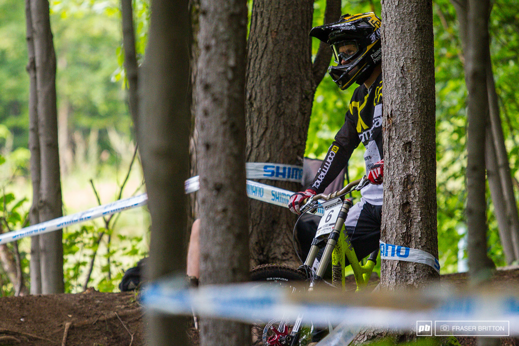 Remi Thirion scoping out the last woods section trying to lock down another stellar result. 31st on the day and he s got some time to make up tomorrow.