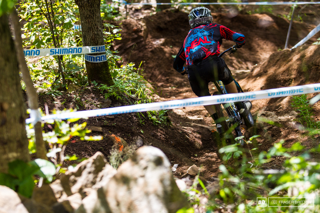 Dan Stanbridge makes his way through the corkscrew berms on his way to the rockdrop.