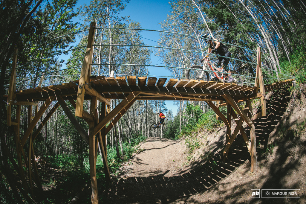 A perfect example of Kevin Eskelin s emphasis on user friendly trail intersections. Meg Broswick crosses while Andre Dube shows off his new whip skills after a week long trip to Whistler.