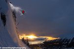 Sam Cohen sending it over an Alaska sunset