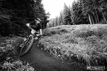 Craig Parker enjoying the final stage of the 2013 Oregon Enduro Series race.  This section has been used for DH races from 20 years at Ski Bowl.  It's not super technical as it winds back and forth between tree lines but it is possible to wash out in a corner and lose time.