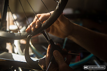 Leave nothing to chance on race day. Spokes must be tensioned, pressures checked, and tires ready in case conditions change. It's all about preparation.