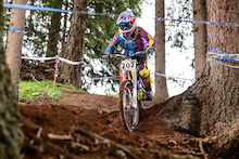 The 11years old Maximilian Koci (AUT) races down the downhill track of the Bikepark Serfaus-Fiss-Ladis during the Kona MTB Festival Serfaus-Fiss-Ladis.ROOKIES in Tyrol, Austria, on August 9, 2014.Free image for editorial usage only: Photo by Felix Schüller.