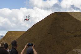 Cam Zink Sending the last jump with a massive Superman seat grab flip. 2015 Crankworx Slopestyle.