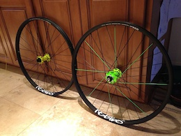 Could I get a quick opinion from y'all? This is the wheelset I just mocked up for my coming street build. I had a just a few of these green spokes from back in the day, thanks to the great Señor King. They match the one darker green end of the rear hub real well (the main reason I even thought of using them) so I just staggered 8 of them only on the one matching side mixed in with the black spokes for the rest. So then that's how it is, just 8 intermingled on that side, a lopsided effect. One change I am thinking of doing though is to tuck the green ones behind the crossing black ones so it has more or a contrast at that point. So what say, yay or nay??