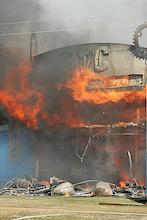 Fire destroys shop, blankets city in smoke