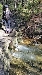 Christine on the trail at one of the small creeks that help fill the small spring fed lake at CSP.