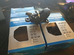 Shimano BR-MT520 4 piston calipers.